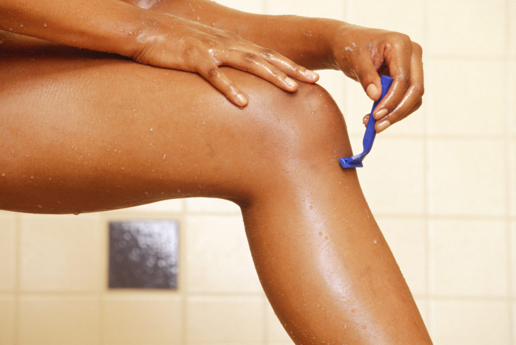 Bahamian Woman shaving legs in shower, low section, close-up, Elife 242, Magazine